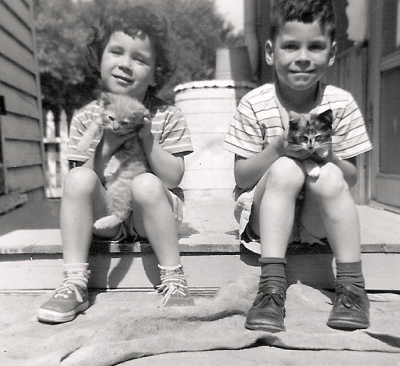 Connie Van Hoven with brother and kittens